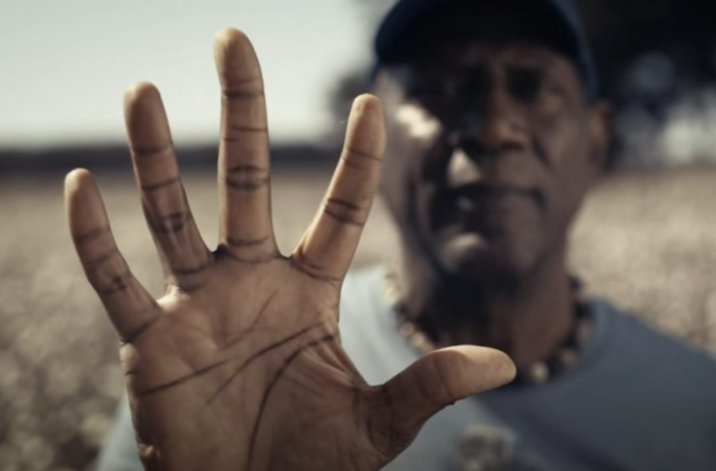 Spencer Haywood on the cotton field with his hand out