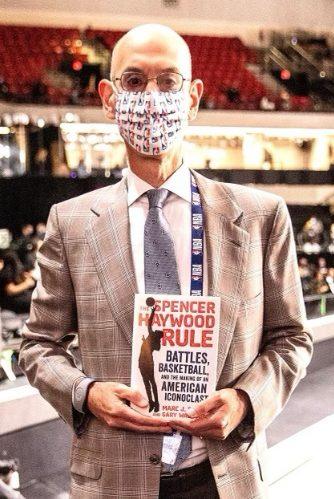 NBA commissioner holding Spencer Haywood's book
